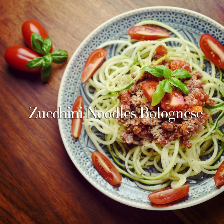 Zucchini noodles called zoodles with vegan bolognese and yeast flakes