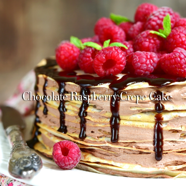 Pancake chocolate cake with fresh raspberry.